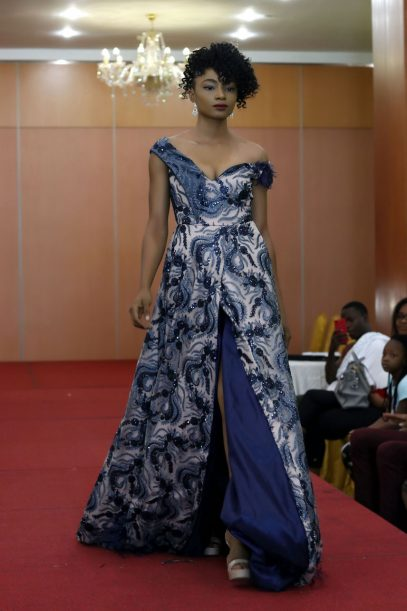 Martwayne Beginners Course in Fashion Design Student, Esther, models her design on the runway